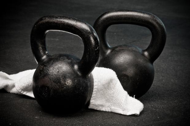 kettlebells-with-towel-on-gym-floor
