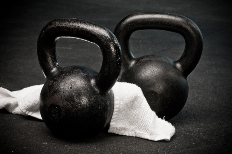 kettlebells-with-towel-on-gym-floor